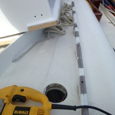 Vent placement near dinghy to protect from entangling lines
