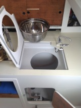 Painted countertop (Interlux Perfection). Open hatch, empty space for bucket