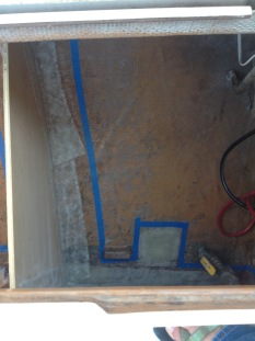 Locker divider, fiberglass detail, we also fiberglassed over the raw water thru hull