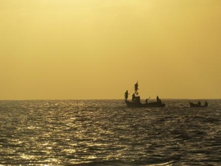 Fishermen go about their work
